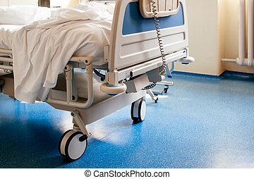 Empty hospital bed on hospital ward - Empty modern hospital...