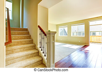 Empty house interior. Living room with staircase