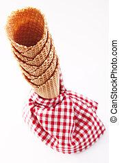 Empty ice-cream cones with checkered napkin
