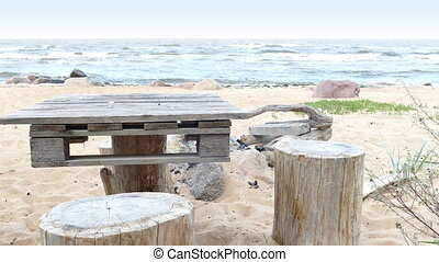 Improvised Wooden Picnic Table on Sandy Beach - Empty...