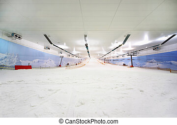 Empty indoor lighting ski; many white snow; funicular; place...