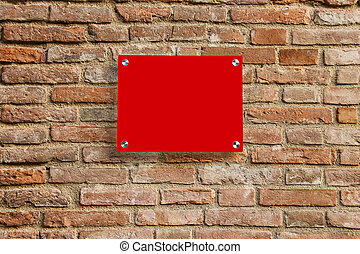 Empty information sign on old brick wall. Red color