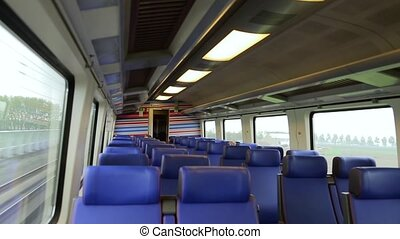 Empty interior of a passenger train car in motion