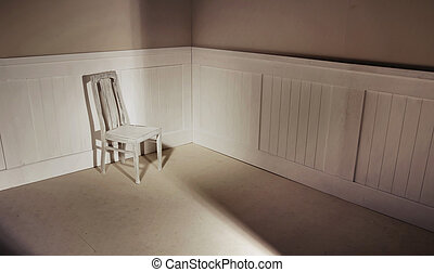Empty interior with chair against wall