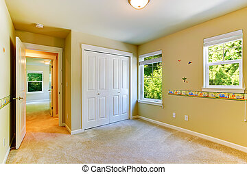 Empty cheerful kids room with painted walls and closet