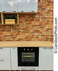 empty kitchen with stove in modern home interior