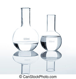 Empty laboratory flasks with a clear liquid, isolated