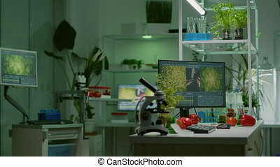 Empty laboratory with nobody in it prepared for genetic test using professional microscope. Biochemistry lab eqquiped with high tech tools for pharmaceutical plant GMO biology medical research test