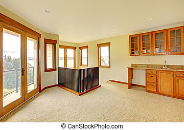 Empty large room with wood cabinets. New luxury home interior.