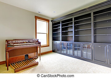 Empty library office room with piano. New luxury home interior.
