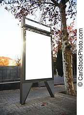Empty lightbox on the city streets, sunlight. Blank mockup
