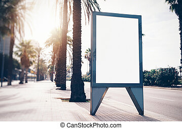 Empty lightbox on the street of a city. Vertical - Blank...