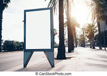 Empty lightbox on the street of a city. Vertical