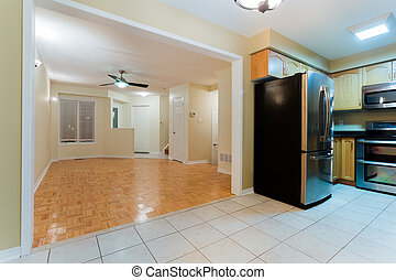 Empty living room with kitchen