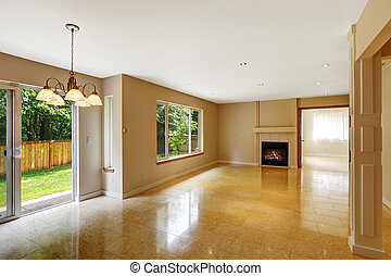 Empty living room with shiny marble tile floor and fireplace...