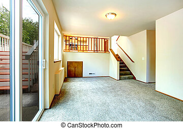 Empty living room with walkout deck