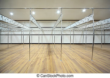 Empty locker room is constructed from metallic pipes with ...
