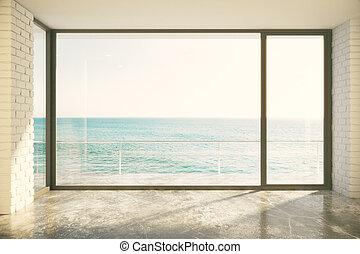 Empty loft room with big window in floor and ocean view