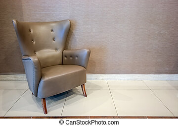 Empty luxury style chair on wall background with clipping path