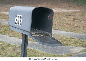 Empty mailbox on metal support