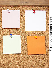 Empty memo notes on cork board