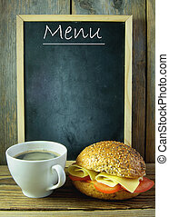 Empty menu board - Empty menu next to a cup of coffee and ...