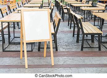 Empty menu board on street
