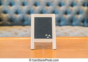 Empty menu board on table