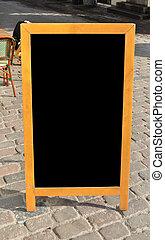 Empty menu board standing on the street