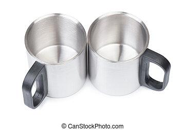 Empty metal mugs