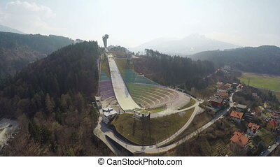 """Empty modern Bergisel ski jump training center during low..."