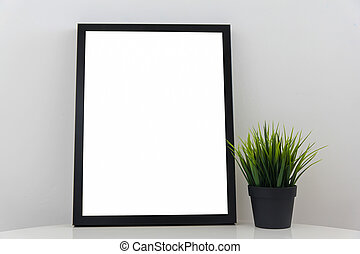 Empty Modern Black Frame On White Glossy Table With Decorative Grass In Flowerpot Light Gray Background Wall White Blank Advertisement Banner Mock Up Isolated Template