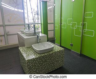 Empty modern restroom interior with washstands