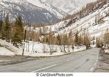 Route numer N506 view from place between Col de Montets (France) and Col de la Forclaz (Switzerland) pass. Empty asphalt road.