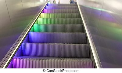 Empty moving color staircase running up and down. Modern...