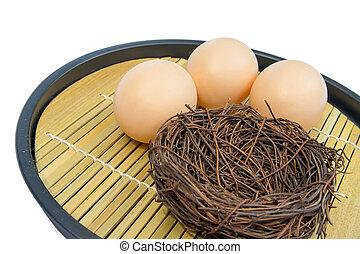 Empty nest with eggs on bamboo matt