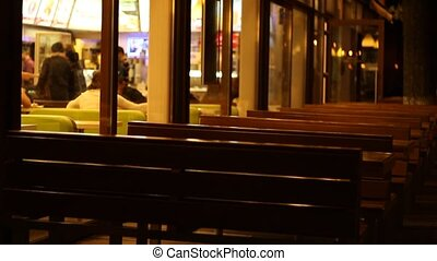 Empty Nigh Fast Food - Empty benches of a fast food place,...