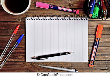 Empty notepad with office utensil on desk