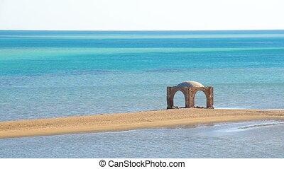 Empty ocean beach on sea shore coast. Outdoor summer vacation background