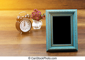 Empty of old style antique wooden photo frame and alarm clock with clipping path