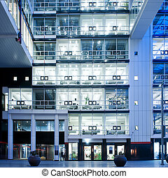 Empty Offices - Many identical empty office cubicles in a...