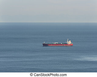 Empty oil tanker alone in the middle of calm ocean