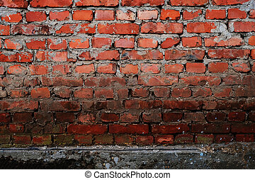 Brick wall of an old house. Texture of a brickwall of an old building. Brickwork close-up. Architectural vintage masonry