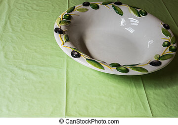 old plate on table with tablecloth