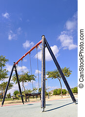 Empty Old Wood Playground Swings