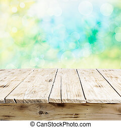 Empty old wooden table in fresh sunlight