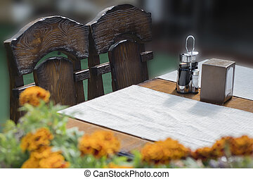 Empty outdoor restaurant table at sunset