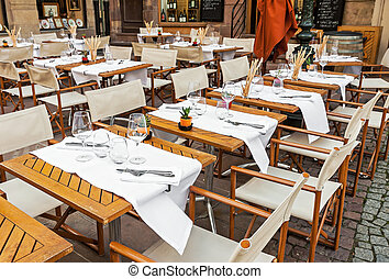 Empty outdoor restaurant with table set