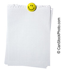 Empty pages from spiral notebook stackes with yellow smiling...