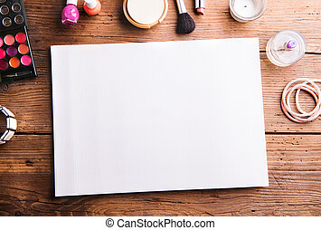 Empty paper sheet laid on table. Make up products.